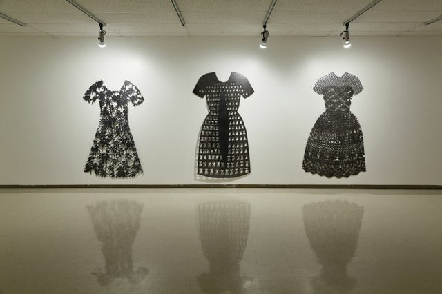 "Barb Hunt, (l to r) ""Lace Dress,"" 1995, plasma-cut, cold-rolled steel, ""Small Dresses,"" 1994, plasma-cut cold-rolled steel, Collection of the Canada Council Art Bank, ""Orchid Dress,""1993, plasma-cut cold-rolled steel."
