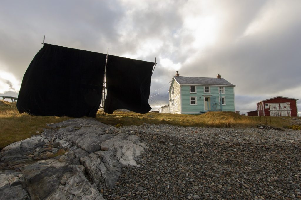 Abbas Akhavan, script for an island (2019), Fogo Island Gallery. Outdoor Installation: velvet curtain, scaffolding. Photo by Alexander Ferko.